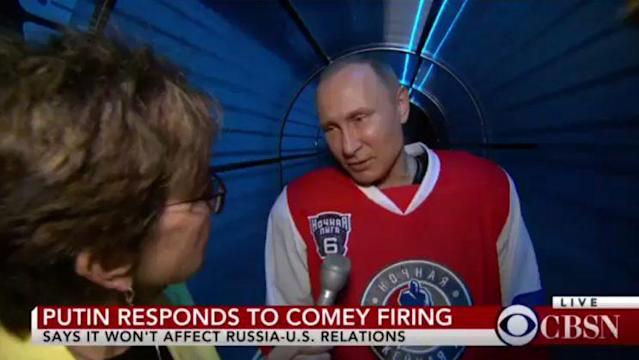 Vladimir Putin answers questions outside a hockey rink. (CBS News)