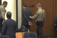 """FILE - In this April 20, 2021, file photo, from video, former Minneapolis police officer Derek Chauvin is taken into custody as his attorney Eric Nelson, left, watches, after his bail was revoked after he was found guilty on all three counts in his trial for the 2020 death of George Floyd, Tuesday,, in Minneapolis. Former Minneapolis police Officer Derek Chauvin faces decades in prison when he is sentenced Friday, June 25, 2021, following his murder and manslaughter convictions in the death of George Floyd. Floyd's death, filmed by a teenage bystander as Chauvin pinned Floyd to the pavement for about 9 and a half minutes and ignored Floyd's """"I can't breathe"""" cries until he eventually grew still, reignited a movement against racial injustice that swiftly spread around the world and continues to reverberate. (Court TV via AP, Pool, File)"""