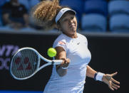 FILE - In this Tuesday, Feb. 2, 2021 file photo, Japan's Naomi Osaka makes a forehand return to France's Alize Cornet during a tuneup tournament ahead of the Australian Open tennis championships in Melbourne, Australia. No. 3 Naomi Osaka – Won the second of her three Grand Slam titles at the Australian Open in 2019.(AP Photo/Andrew Brownbill, File)