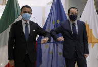 Cypriot Foreign Minister Nicos Christodoulides, right, and Italian Foreign Minister Luigi Di Maio greet each other prior to their meeting at the Foreign Ministry house in Nicosia, Cyprus, March 9, 2021. Maio is in Cyprus for one-day visit. (Yiannis Kourtoglo/Pool via AP)