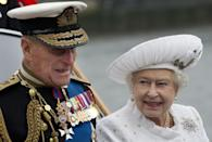 The Queen smiling at Prince Philip while they are both aboard the flotilla for her Diamond Jubilee in 2012. More than 1,000 boats from the Commonwealth paraded down the Thames, the largest flotilla seen on the river for centuries.