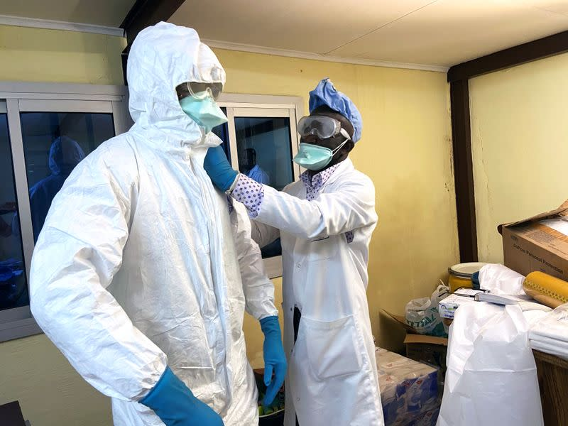 A medical staff wears protective gear at a new section specialised in receiving any person who may have been infected with coronavirus at The Quinquinie Hospital in Douala,