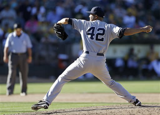 New York Yankees relief pitcher Mariano Rivera throws in the 18th inning of a baseball game against the Oakland Athletics Thursday, June 13, 2013, in Oakland, Calif. Oakland won the game 3-2 in 18 innings. (AP Photo/Eric Risberg)