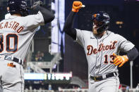 Detroit Tigers' Eric Haase (13) gets congratulated by Harold Castro after Haase's solo home run off Minnesota Twins' relief pitcher Tyler Duffey (21) in the seventh inning of a baseball game, Monday, July 26, 2021, in Minneapolis. The Twins won 6-5 in 10 innings. (AP Photo/Jim Mone)