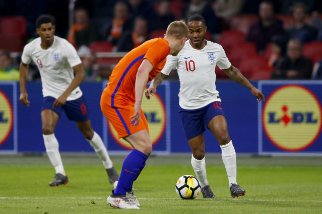 England's Raheem Sterling, right, competes for the ball with Matthijs de Ligt of the Netherlands during the international friendly soccer match between the Netherlands and England at the Amsterdam ArenA in Amsterdam, Netherlands, Friday, March 23, 2018. (AP Photo/Peter Dejong)