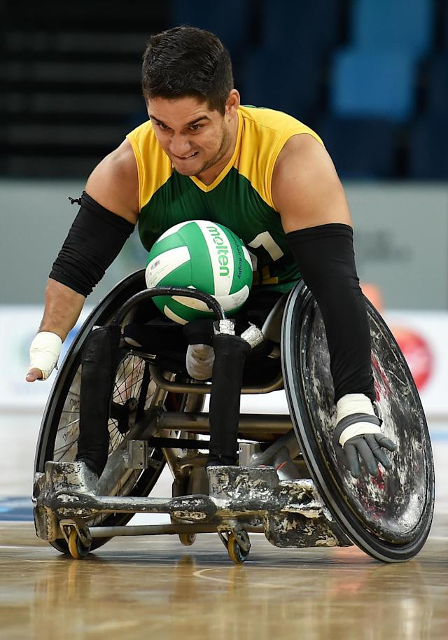 RIO DE JANEIRO, BRAZIL - FEBRUARY 26: Julio Cesar Braz of Brazil scores a try during the International Wheelchair Rugby Championship - Aquece Rio Test Event for the Rio 2016 Paralympics match between Brazil and Canada at Olympic Park on February 26, 2016 in Rio de Janeiro, Brazil. (Photo by Buda Mendes/Getty Images)