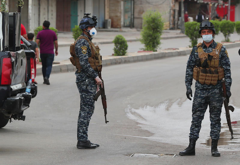 Security forces are deployed to enforce a curfew to help fight the spread of the coronavirus. in central Baghdad, Iraq, Tuesday, March 31, 2020. The new coronavirus causes mild or moderate symptoms for most people, but for some, especially older adults and people with existing health problems, it can cause more severe illness or death. (AP Photo/Hadi Mizban)