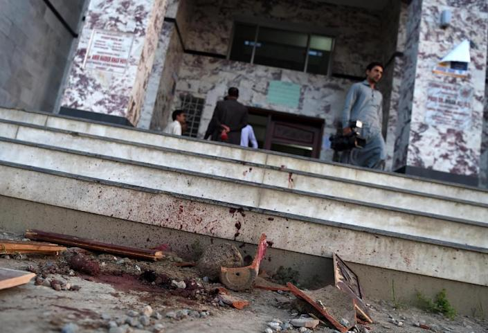 Blood stains are seen on a wall and the ground at a hostel at Abdul Wali Khan university at the site of where students beat to death a classmate in Mardan on April 13, 2017 (AFP Photo/ABDUL MAJEED)