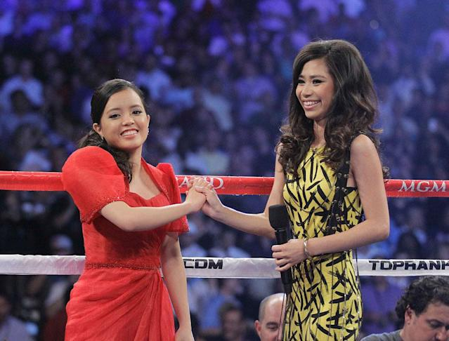 """""""American Idol"""" runner-up Jessica Sanchez, right, and Kirby Asunto stand in the ring before the WBO welterweight title fight between Manny Pacquiao, from the Philippines, and Timothy Bradley, from Palm Springs, Calif., Saturday, June 9, 2012, in Las Vegas."""