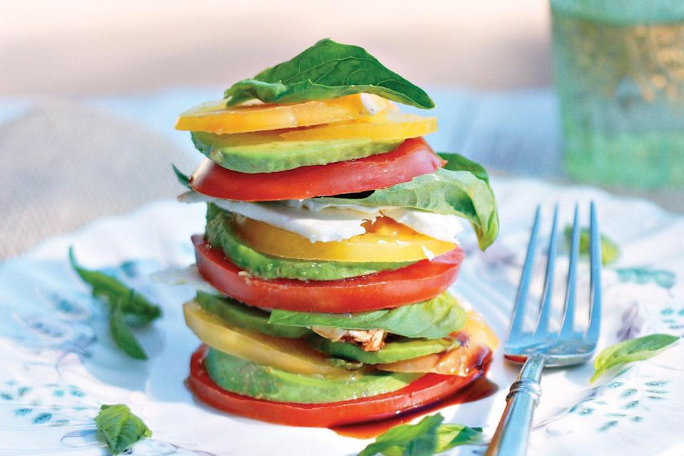 """Wait for summer to make this all-star stack of avocado, heirloom tomato, feta cheese, basil, balsamic vinegar, olive oil, salt, and freshly cracked black pepper. <a href=""""https://www.epicurious.com/recipes/food/views/tomato-basil-avocado-and-feta-stacks?mbid=synd_yahoo_rss"""" rel=""""nofollow noopener"""" target=""""_blank"""" data-ylk=""""slk:See recipe."""" class=""""link rapid-noclick-resp"""">See recipe.</a>"""