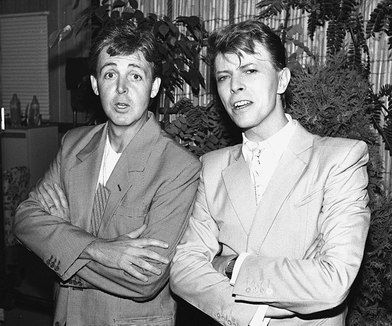 Singers Paul McCartney (L) and David Bowie (R) back stage at Wembley for Live Aid in 1985, London.