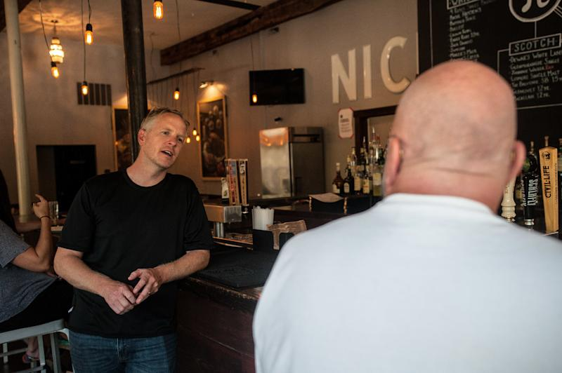 Chris Sommers, owner of Pi Pizzeria, talks to supportive customers in his Central West End location in St. Louis on Wednesday.