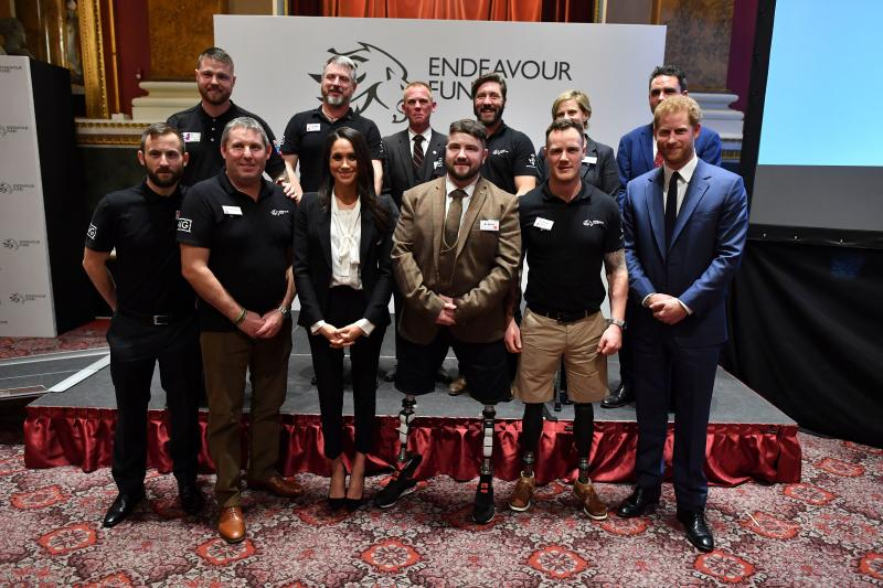 Britain's Prince Harry (front R) and his fiancee US actress Meghan Markle (front 3L) pose with award winners Ben Lee (front 3R), Sean Gane (back 2L) and Daniel Claricoates (back 3L) and the award nominees during the annual Endeavour Fund Awards at Goldsmiths' Hall in London on February 1, 2018. Prince Harry and Meghan Markle attended the second annual Endeavour Fund Awards ceremony in London. The Endeavour Fund Awards celebrate the achievements of wounded, injured and sick veterans who have taken part in remarkable sporting and adventure challenges as part of their recovery and rehabilitation. / AFP PHOTO / POOL / Ben STANSALL (Photo credit should read BEN STANSALL/AFP via Getty Images)