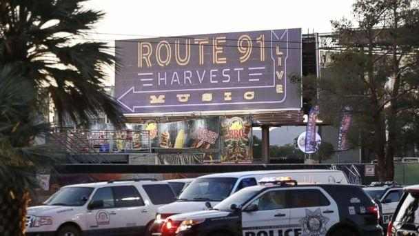 PHOTO: Las Vegas Metropolitan Police in front of a sign for the Route 91 Harvest festival near the scene of the mass shooting at the Route 91 Harvest festival on Las Vegas Boulevard in Las Vegas, Oct. 2, 2017. (Paul Buck/EPA)