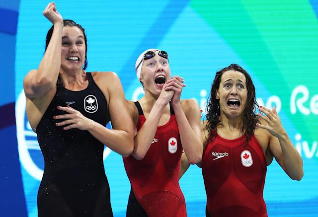<p>Chantal van Landeghem, Taylor Ruck, and Sandrine Mainville of Canada celebrate third in the final of the Women's 4 x 100m Freestyle Relay on Day 1 of the Rio 2016 Olympic Games at the Olympic Aquatics Stadium on August 6, 2016 in Rio de Janeiro, Brazil. (Photo by Ian MacNicol/Getty Images) </p>
