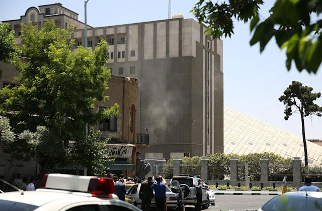 <p>Smoke is seen during a gunmen attack at the parliament's building in central Tehran, Iran, June 7, 2017. (Photo: TIMA via Reuters) </p>