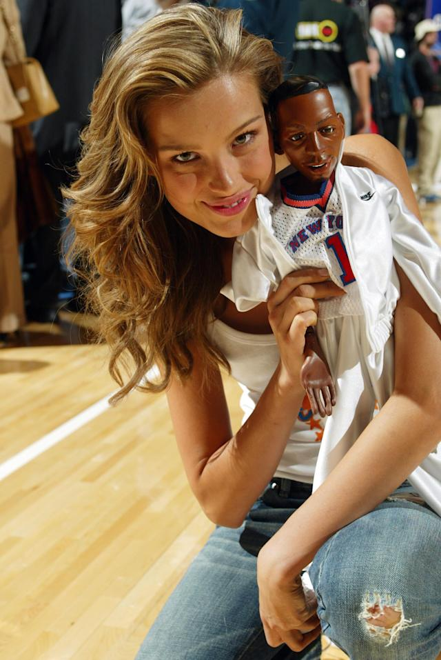 <p>Petra Nemcova poses with a Lil Penny doll at the New York Knicks v. Rockets game at Madison Square Garden in 2004. </p>