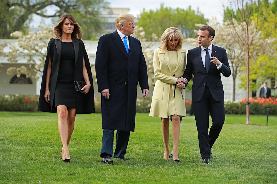For the French couple's three-day visit to the White House, Melania Trump opted for a cape-like dress by Givenchy with co-ordinating Christian Louboutin heels. [Photo: Getty]