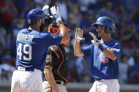 Mar 28, 2017; Mesa, AZ, USA; Chicago Cubs second baseman Chesny Young (85) celebrates with Jake Arrieta (49) after hitting a two run homerun in the third inning against the San Francisco Giants during a spring training game at Sloan Park. Mandatory Credit: Rick Scuteri-USA TODAY Sports