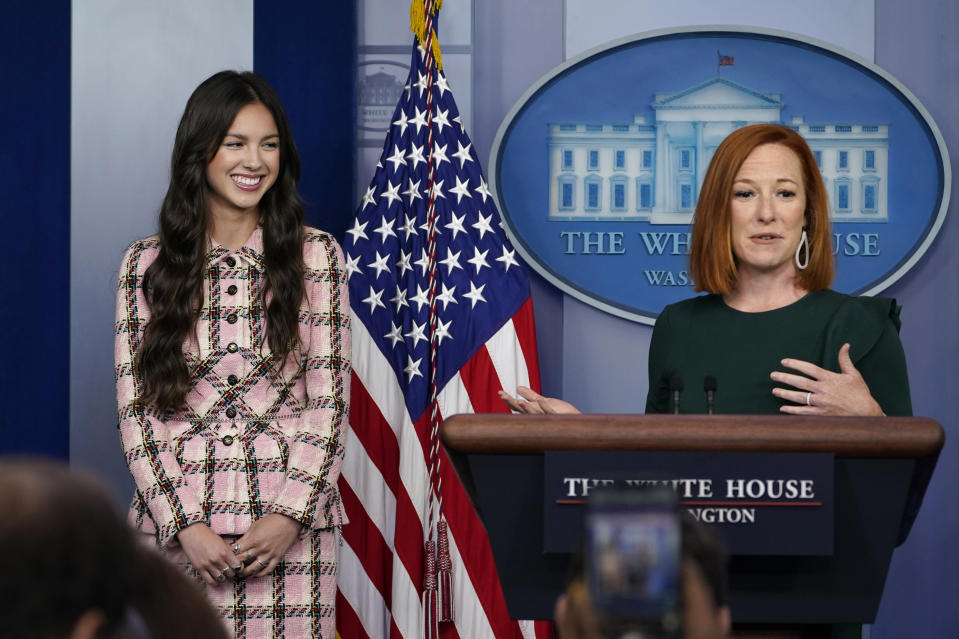 White House press secretary Jen Psaki, right, speaks about teen pop star Olivia Rodrigo, left, during the daily briefing at the White House in Washington, Wednesday, July 14, 2021. Rodrigo is at the White House to film a video to promote vaccines. (AP Photo/Susan Walsh)