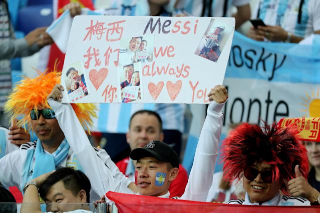 Soccer Football - World Cup - Group D - Argentina vs Croatia - Nizhny Novgorod Stadium, Nizhny Novgorod, Russia - June 21, 2018 Fan holds up sign referencing Argentina's Lionel Messi REUTERS/Lucy Nicholson