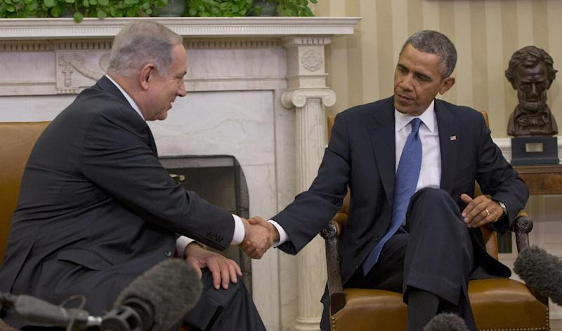 President Barack Obama and Israeli Prime Minister Benjamin Netanyahu shake hands during their meeting in the Oval Office of the White House in Washington, Monday, March 3, 2014. Seeking to keep a pair of delicate diplomatic efforts afloat, Obama will personally appeal to Netanyahu to move forward on peace talks with the Palestinians, while also trying to manage Israel's deep suspicion of his pursuit of a nuclear accord with Iran. (AP Photo/Pablo Martinez Monsivais)