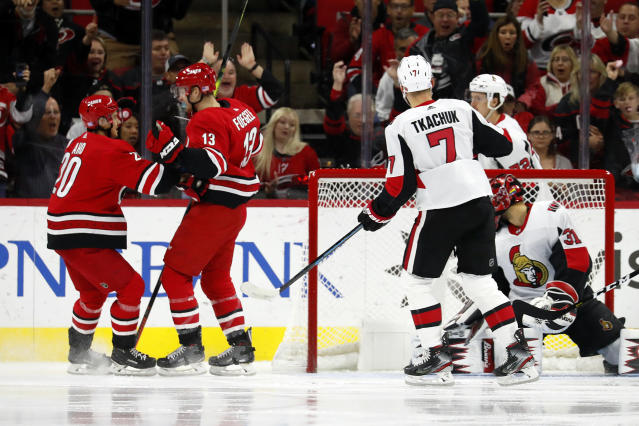 Carolina Hurricanes' Warren Foegele (13) celebrates his goal with teammate Sebastian Aho (20), of Finland, during the first period of an NHL hockey game against the Ottawa Senators in Raleigh, N.C., Monday, Nov. 11, 2019. (AP Photo/Karl B DeBlaker)