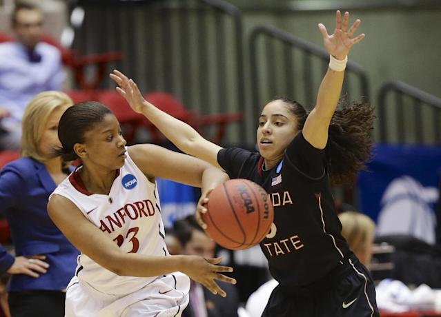 Stanford's Amber Orrange (33) passes the ball past Florida State's Cheetah Delgado (5) in the first half of a second-round game in the NCAA women's college basketball tournament in Ames, Iowa, Monday, March 24, 2014. (AP Photo/Nati Harnik)