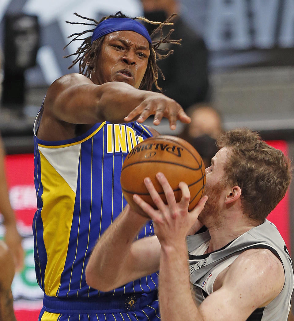 SAN ANTONIO, TX - APRIL 03: Myles Turner #33 of the Indiana Pacers blocks shot of Jakob Poeltl #25 of the San Antonio Spurs in the first half at AT&T Center on April 3, 2021 in San Antonio, Texas.  NOTE TO USER: User expressly acknowledges and agrees that, by downloading and or using this photograph, User is consenting to the terms and conditions of the Getty Images License Agreement. (Photo by Ronald Cortes/Getty Images)