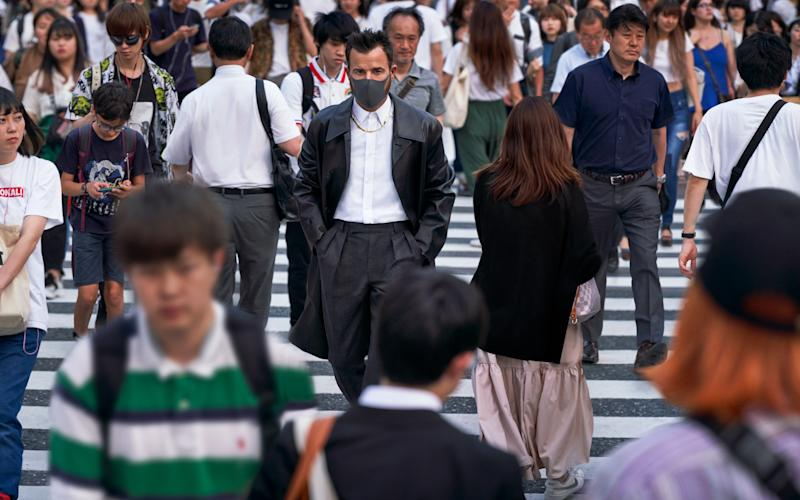 """""""The Shibuya Crossing is, obviously, sort of famous for that Lost in Translation shot, with hoards of people crossing at intervals— it's still an incredible spectacle. It's like watching this big 3,000-person ballet every three minutes. Sadly, the best view of it is from Starbucks on the second floor, directly above it."""""""