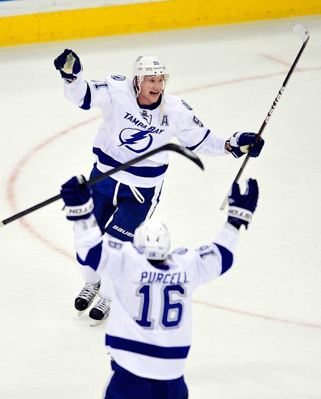 RALEIGH, NC - MARCH 03: Steven Stamkos #91 celebrates with teammate Teddy Purcell #16 of the Tampa Bay Lightning after scoring the game-winning goal against the Carolina Hurricanes during overtime at the RBC Center on March 3, 2012 in Raleigh, North Carolina. The Lightning won 4-3 in overtime. (Photo by Grant Halverson/Getty Images)