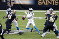 Carolina Panthers quarterback Teddy Bridgewater scrambles under pressure from New Orleans Saints defensive end Cameron Jordan (94) and defensive tackle Malcom Brown (90) in the second half of an NFL football game in New Orleans, Sunday, Oct. 25, 2020. (AP Photo/Butch Dill)