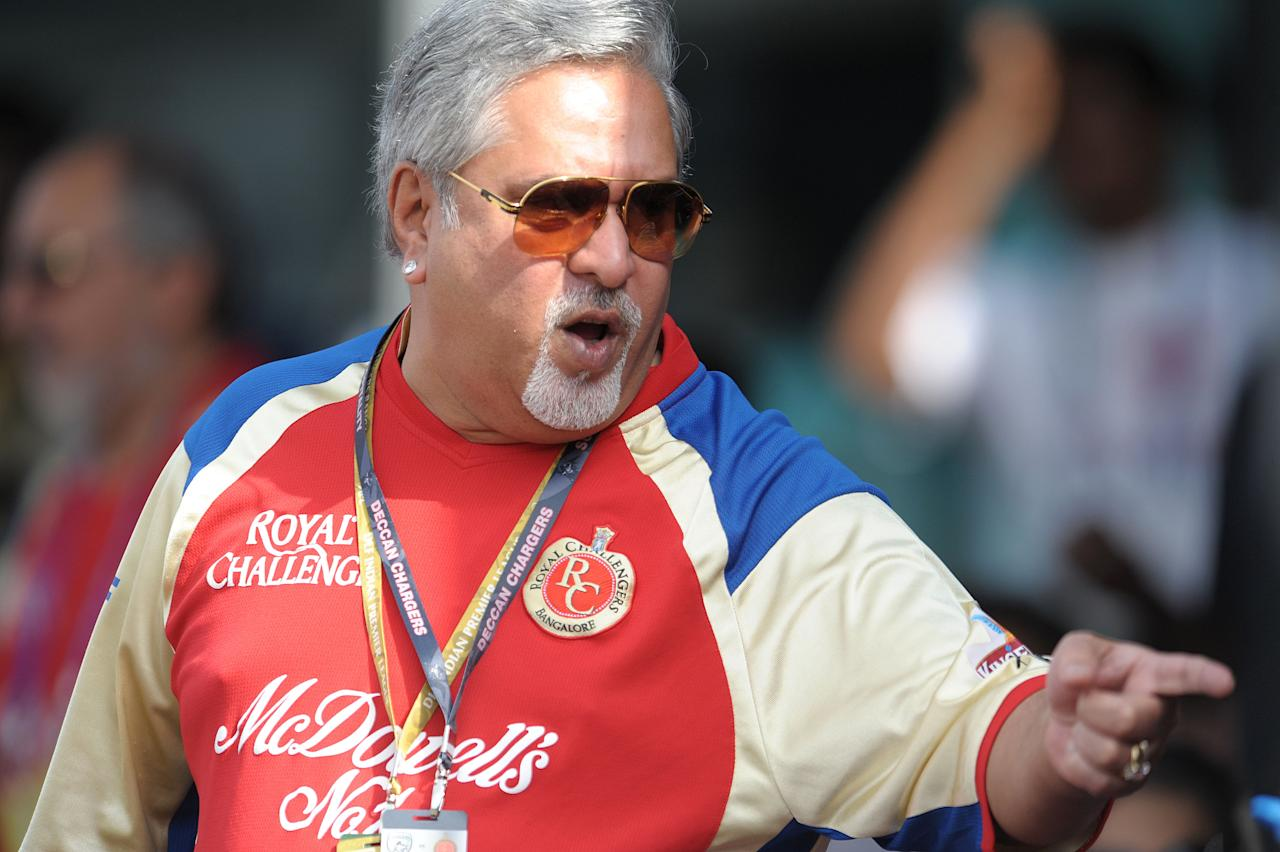 Royal Challengers Bangalore owner Vijaya Mallya gestures prior to the start the IPL Twenty20 cricket match between the Deccan Chargers and Royal Challengers Bangalore at Rajiv Gandhi International Stadium in Hyderabad on May 20, 2012.  RESTRICTED TO EDITORIAL USE. MOBILE USE WITHIN NEWS PACKAGE. AFP PHOTO/ Noah SEELAM        (Photo credit should read NOAH SEELAM/AFP/GettyImages)