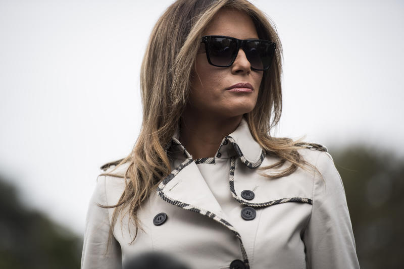 First lady Melania Trump listens as the president speaks to reporters on the South Lawn of the White House in early October. (Jabin Botsford/The Washington Post via Getty Images)