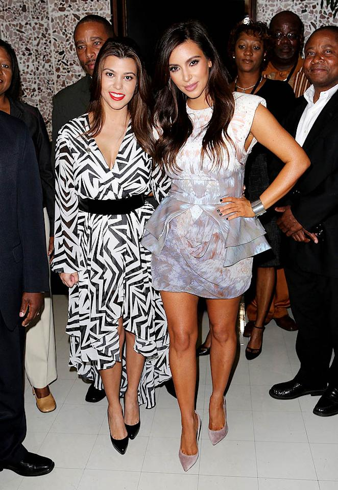 NORTH MIAMI, FL - NOVEMBER 19: Kourtney Kardashian and Kim Kardashian make an appearance at North Miami City Hall to receive keys to the City of North Miami on November 19, 2012 in North Miami, Florida. (Photo by Alexander Tamargo/Getty Images)