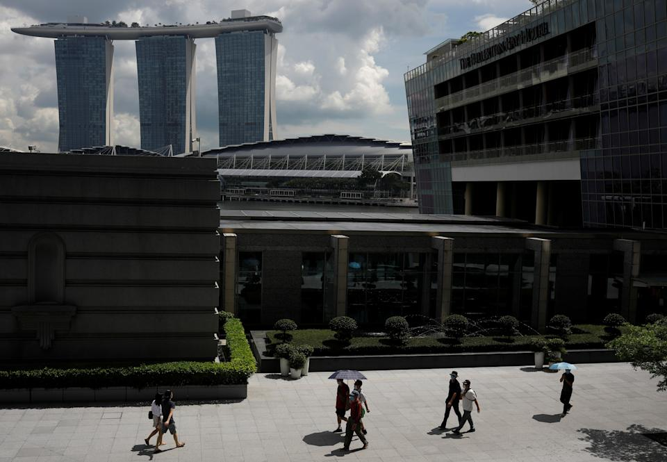 People walking at the central business district in Singapore.