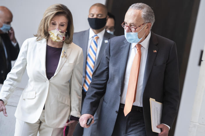 UNITED STATES - AUGUST 06: Speaker Nancy Pelosi, D-Calif., and Senate Minority Leader Charles Schumer, D-N.Y., make their way to a news conference on coronavirus aid in the Capitol Visitor Center on Thursday, August 6, 2020. (Photo By Tom Williams/CQ-Roll Call, Inc via Getty Images)