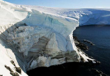 FILE PHOTO: Melting ice shows through at a cliff face at Landsend, on the coast of Cape Denison, Antarctica January 2, 2010. REUTERS/Pauline Askin/File Photo