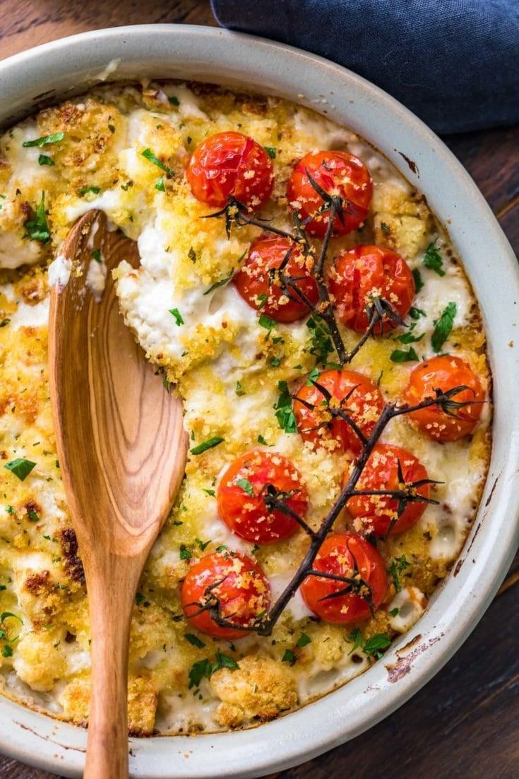 "<p>Cauliflower is a great low-carb substitute for potatoes, so this cheesy cauliflower au gratin is a must at your Thanksgiving table this year. The recipe serves six, so cut all of the ingredient measurements in half to make a more manageable amount for two. </p><p><strong>Get the recipe:</strong> <a href=""http://www.thecookierookie.com/cheesy-cauliflower-au-gratin-recipe/"" class=""link rapid-noclick-resp"" rel=""nofollow noopener"" target=""_blank"" data-ylk=""slk:cheesy cauliflower au gratin"">cheesy cauliflower au gratin</a></p>"