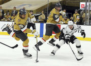Vegas Golden Knights right wing Ryan Reaves (75) shoots as Los Angeles Kings Olli Maatta (6) defends during the second period of an NHL hockey game Sunday, Feb. 7, 2021, in Las Vegas. (AP Photo/Isaac Brekken)
