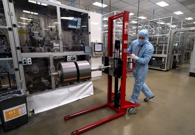 A worker moves components used in the manufacture of the battery for the Nissan Leaf at the Envision AESC UK Ltd battery plant based at Nissan in Sunderland