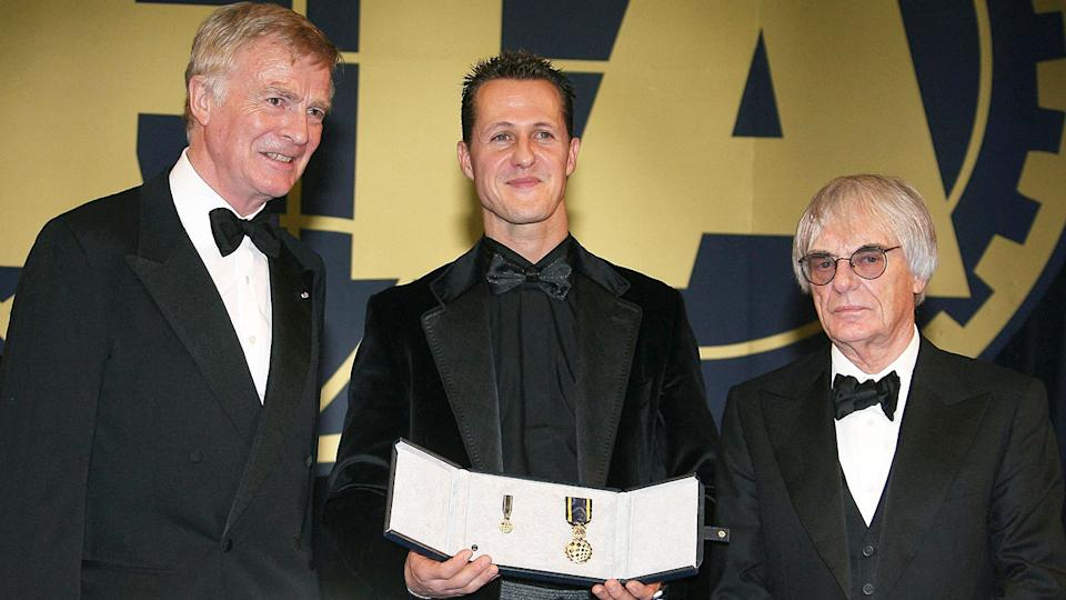 Pictured from left to right are Max Mosley, Michael Schumacher and Bernie Ecclestone.