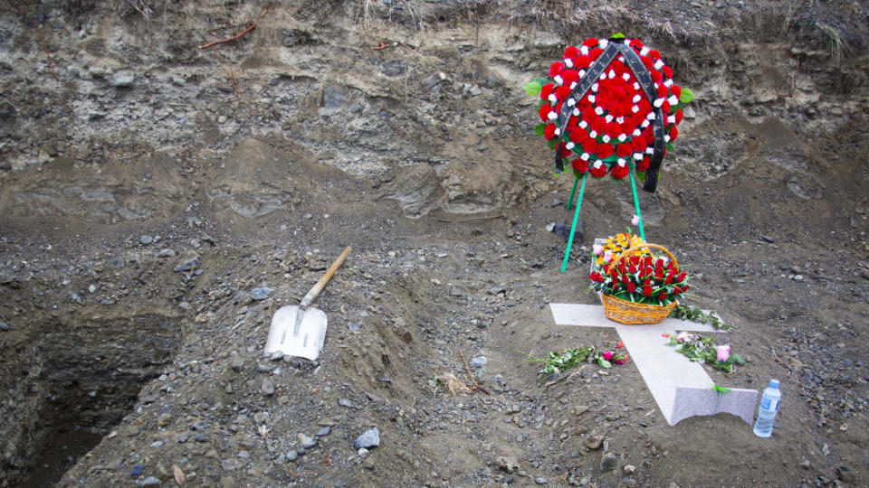 """<div class=""""inline-image__caption""""><p>At the military cemetery in Stepanakert, soldiers are lying next to empty graves, already dug for the next ones to arrive.</p></div> <div class=""""inline-image__credit"""">Emil Filtenborg</div>"""