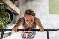 """<p>Liu is also a fan of isometric pull-ups or chin-ups where you hold your chin above the bar.</p> <ul> <li>Place both of your hands on a pull-up bar with your palms facing away from you (pull-up) or facing toward you (chin-up).</li> <li>With a neutral spine and your abs engaged, pull yourself up so that your chin is just above the bar.</li> <li>Hold this position, and focus on engaging your back muscles and keeping your shoulders pressed down away from your ears.</li> <li>Liu suggests starting with 10- to 15-second holds where you can maintain tension in your upper back and core, then work your way up to 30- to 45-second holds.</li> <li>To make this move a bit easier, stand on a chair or stable surface and jump up so that your chin is above the bar (meaning you don't have to do an actual pull-up or chin-up before going into your isometric hold).</li> <li>You can also do this hold with a large resistance band around the bar (like you'd use if you were doing <a href=""""https://www.popsugar.com/fitness/photo-gallery/45207658/image/45207694/Banded-Assisted-Pull-Up"""" class=""""link rapid-noclick-resp"""" rel=""""nofollow noopener"""" target=""""_blank"""" data-ylk=""""slk:assisted pull-ups"""">assisted pull-ups</a>), placing your foot in the bottom of the band and pulling yourself up that way.</li> </ul>"""