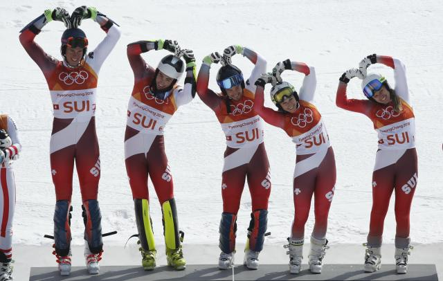 Alpine Skiing - Pyeongchang 2018 Winter Olympics - Team Event - Yongpyong Alpine Centre - Pyeongchang, South Korea - February 24, 2018 - Gold medallist Switzerland's team celebrates on the podium during the victory ceremony. REUTERS/Mike Segar