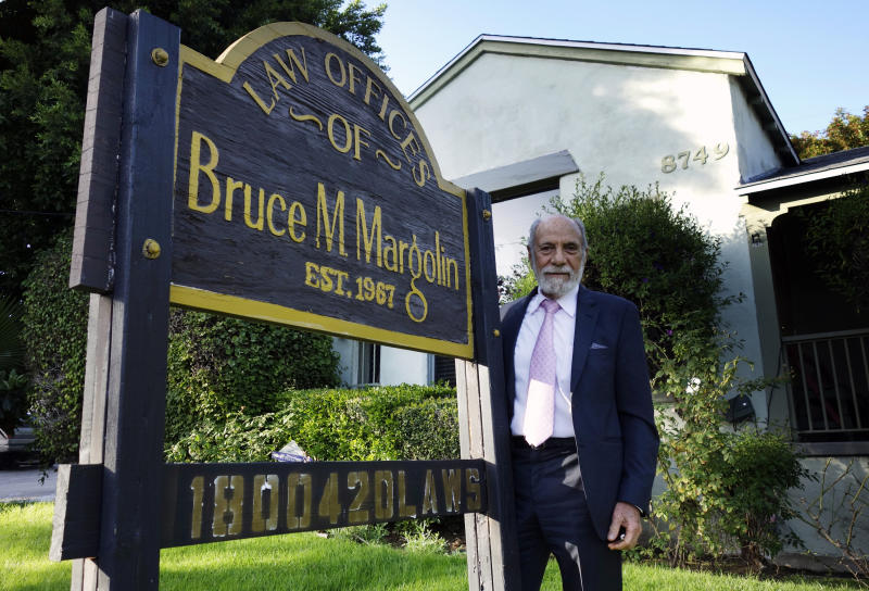 In this Jan. 19, 2917 photo, attorney Bruce Margolin stands by a sign outside his office in West Hollywood, Calif. Marlin, has crusaded for marijuana legalization for decades and is now helping convicts get their felony convictions reduced to misdemeanors under a lesser-known provision of the voter-approved ballot measure that legalized recreational marijuana in California. (AP Photo/Brian Melley)