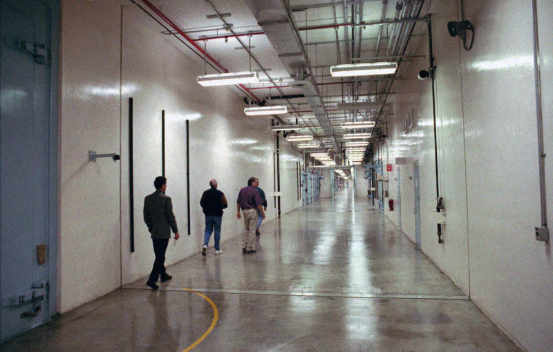 FILE - In this 1997 file photo a group of people walk down a hallway which winds through the Device Assembly Facility which houses 30 separate buildings at the Nevada Test Site in Mercury, Nev. A federal appeals court has ruled against Nevada in a legal battle over the U.S. government's secret shipment of weapons-grade plutonium to a site near Las Vegas. A three-judge panel of the 9th U.S. Circuit Court of Appeals on Tuesday, Aug. 13, 2019, denied the state's appeal after a judge refused to block any future shipments to Nevada. The court in San Francisco says the matter is moot because the Energy Department already sent the radioactive material and has promised that no more will be hauled there. (AP Photo/Lennox McLendon, File)