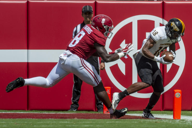 Southern Miss wide receiver De'Michael Harris (18) grabs a touchdown reception as Alabama linebacker Christian Harris (8) arrives too late during the first half of an NCAA college football game, Saturday, Sept. 21, 2019, in Tuscaloosa, Ala. (AP Photo/Vasha Hunt)