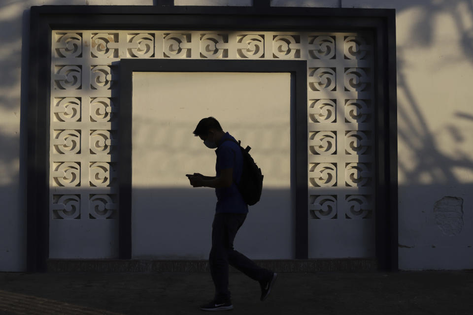 A Health Ministry worker enters a government facility where COVID-19 vaccines are stored in San Salvador, El Salvador, Thursday, May 13, 2021. (AP Photo/Salvador Melendez)