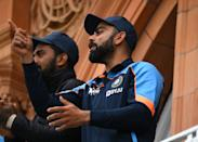 <p>LONDON, ENGLAND - AUGUST 16: India captain Virat Kohli applauds after Shami reaches his 50 during day five of the second Test Match between England and India at Lord's Cricket Ground on August 16, 2021 in London, England. (Photo by Stu Forster/Getty Images)</p>